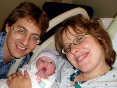 Ian, shortly after birth, with his parents.